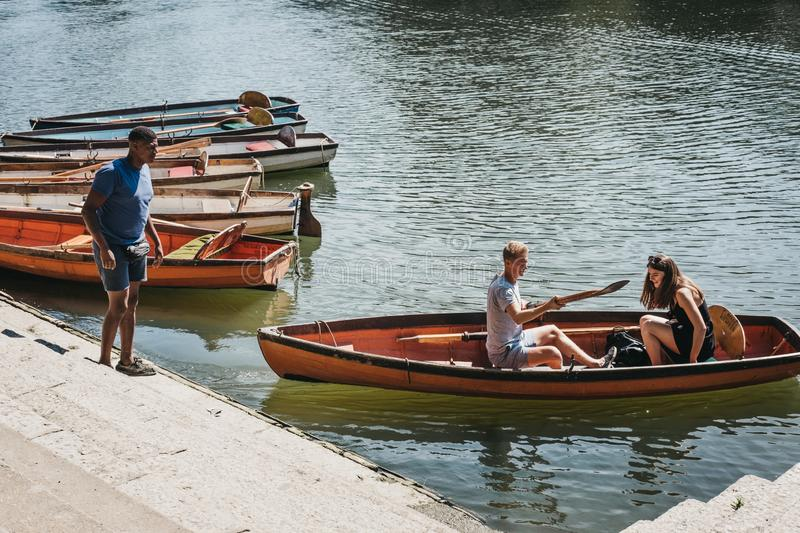 People hire boats from Richmond Bridge Boat Hire on the River Th. London, UK - August 1, 2018. People hire boats from Richmond Bridge Boat Hire on the River royalty free stock photo