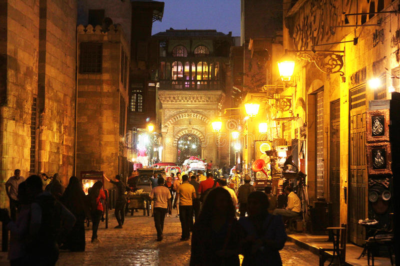 People in historical Moez street in egypt. People walking in historical Moez street at night in old cairo in egypt royalty free stock image