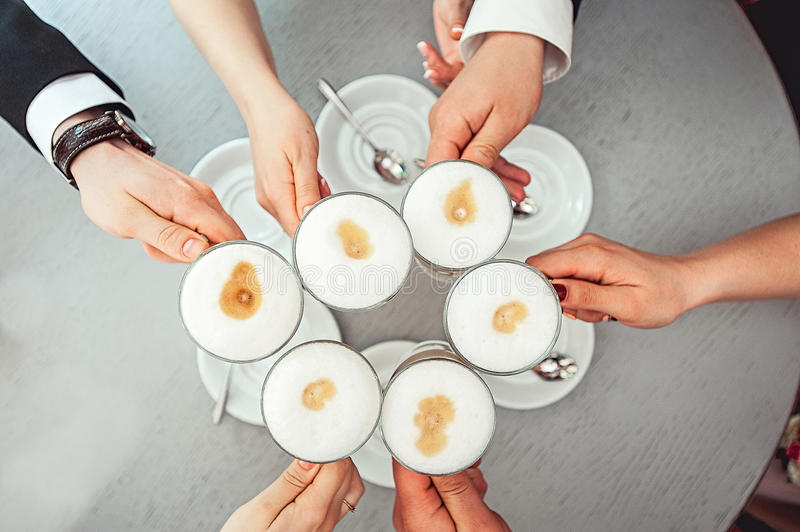 People hold in hands cups with coffe royalty free stock photos
