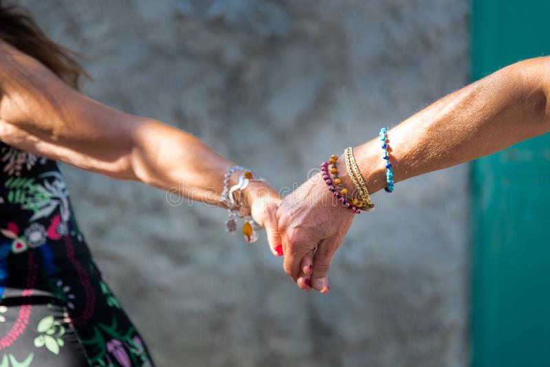 PEOPLE HOLDIN HANDS WITH LOVE royalty free stock image