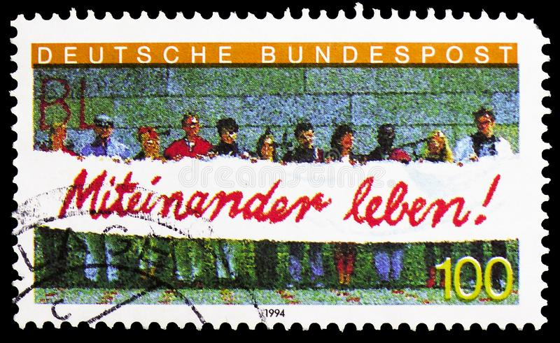 People Holding Banner, `Living Together` Integration of Foreign Workers in Germany serie, circa 1994 stock photos