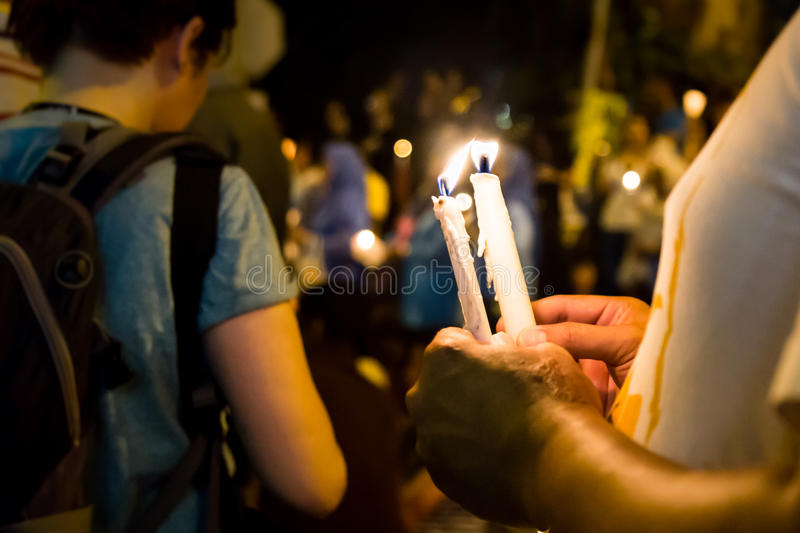 People holding candle vigil in darkness seeking hope, worship, p. Group of people holding candle vigil in darkness seeking hope, worship, prayer royalty free stock photography