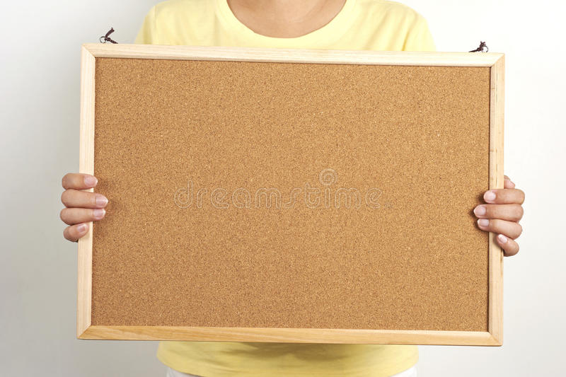 People Holding The Cork Board Stock Image