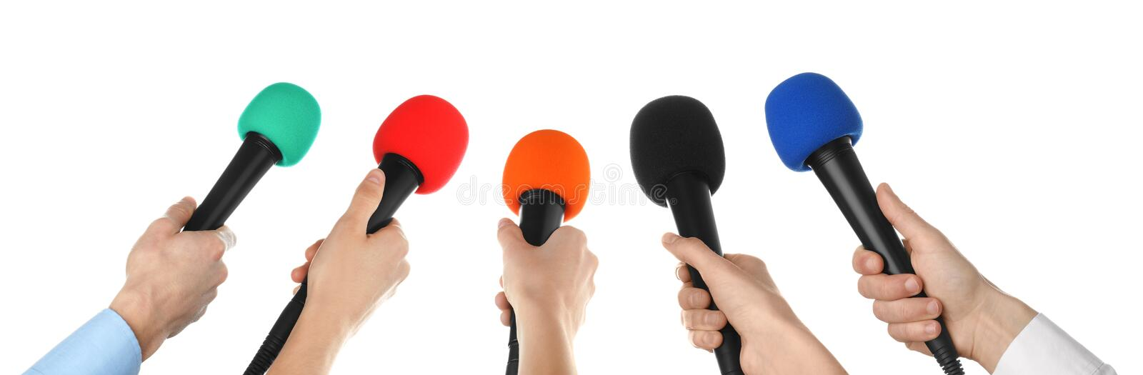 People holding different microphones on white background royalty free stock photo