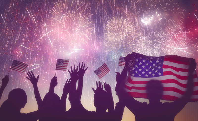 People holding the Flag of USA. Patriotic holiday. Silhouettes of people holding the Flag of USA. America celebrate 4th of July stock image