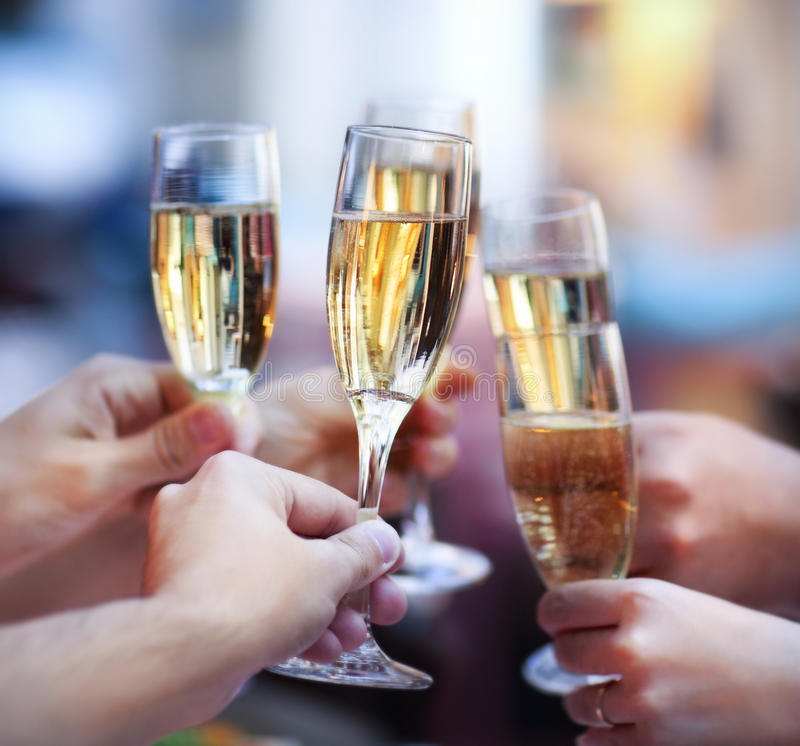 People holding glasses of champagne making a toast. Celebration. People holding glasses of champagne making a toast stock photos