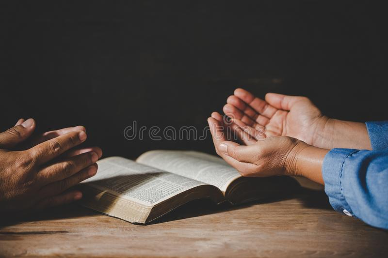 People holding hands praying worship believe. Group of people holding hands praying worship believe, devotional for prayer meeting concept stock photography