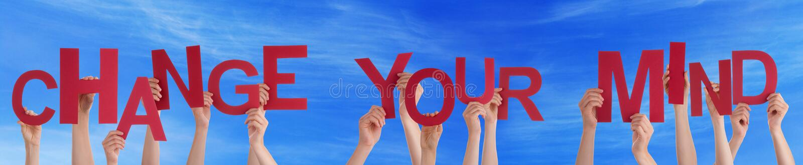 People Holding Red Word Change Your Mind Blue Sky royalty free stock image