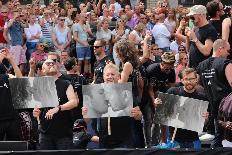 People holding signs in support of gender equality gay pride canal parade stock images