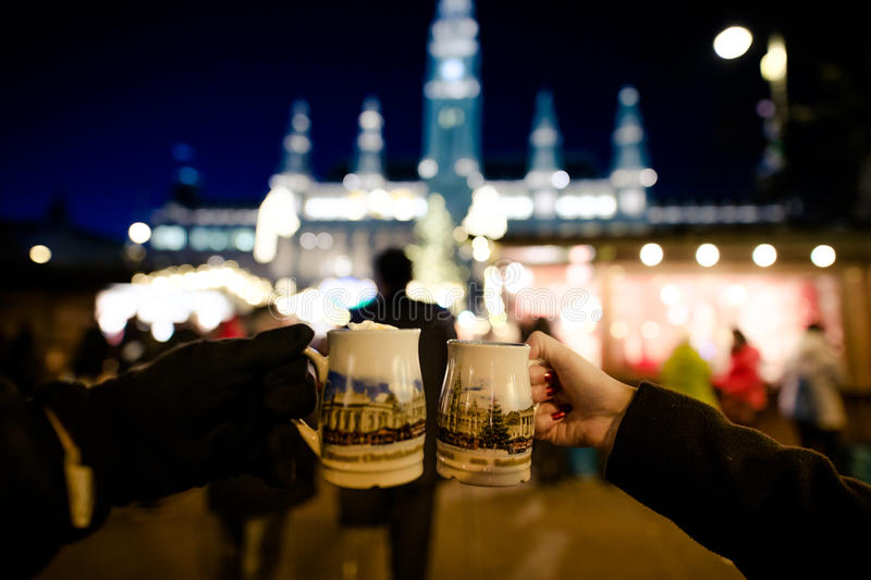 People holding traditional Punch cups in Vienna Christmas Market. December 2016 stock photos