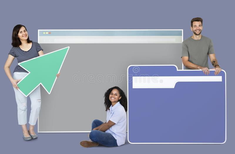 People holding a webpage, a cursor and a folder icons royalty free stock photos