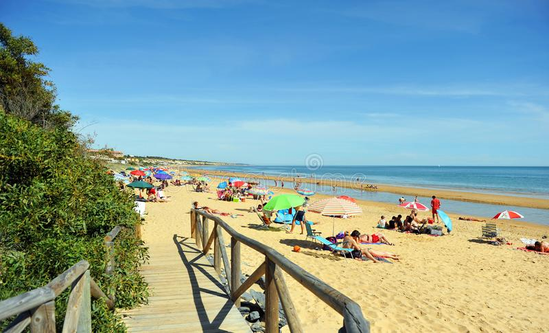 People on holidays at the beach of Mazagon in the province of Huelva, Andalusia, Spain stock images