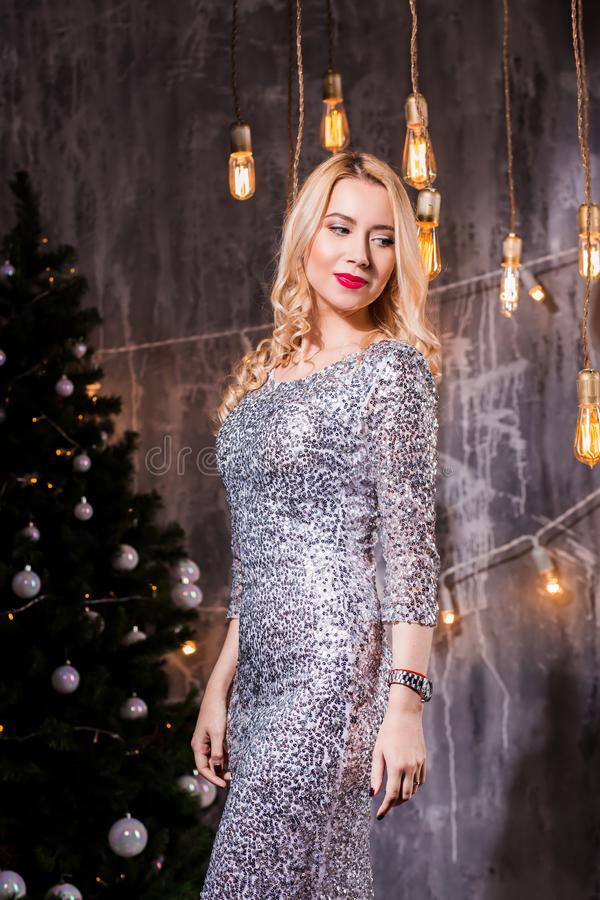 People, holidays and glamour concept - beautiful woman in evening dress. New Year, holiday, celebration, winter, people, holidays and glamour concept, beautiful stock photo