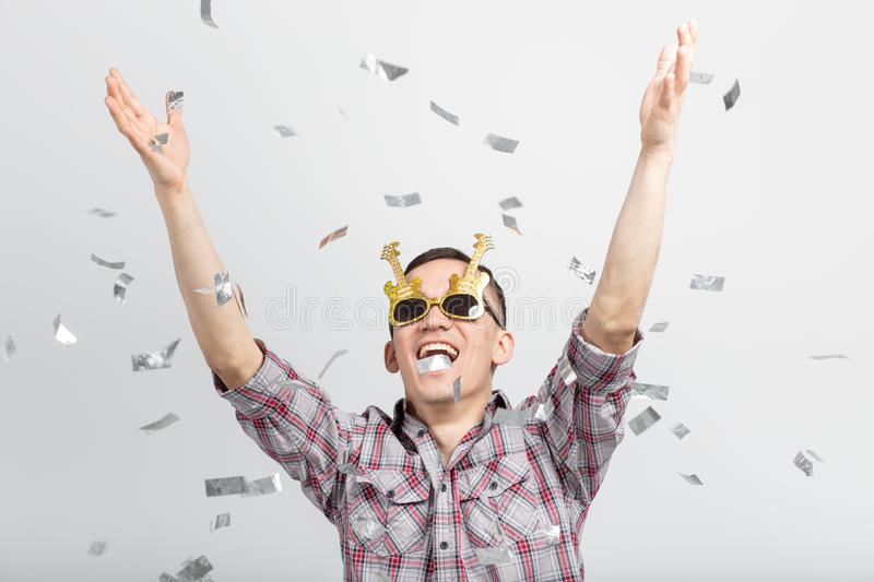 People, holidays and party concept - Cool man in plaid shirt over white background with confetti stock photo