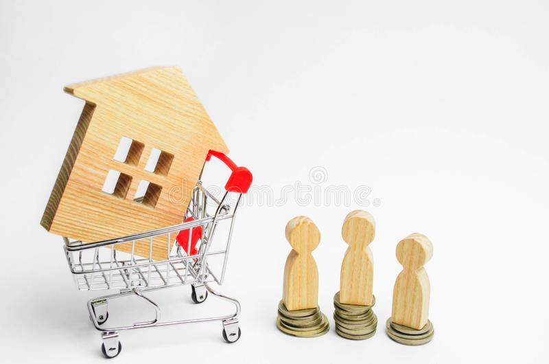 People, house in Supermarket trolley. Auction, public sales, investment attraction. Concept of real estate. Buying, selling and re. Nting a house. Loan for an stock image