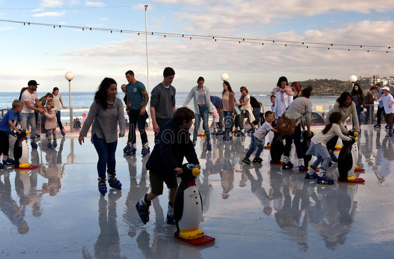 People are ice skating on Bondi ice rink. Sydney, Australia - Jul 17, 2016. People are ice skating on Bondi ice rink. Australia's only beachside ice rink is on royalty free stock photography