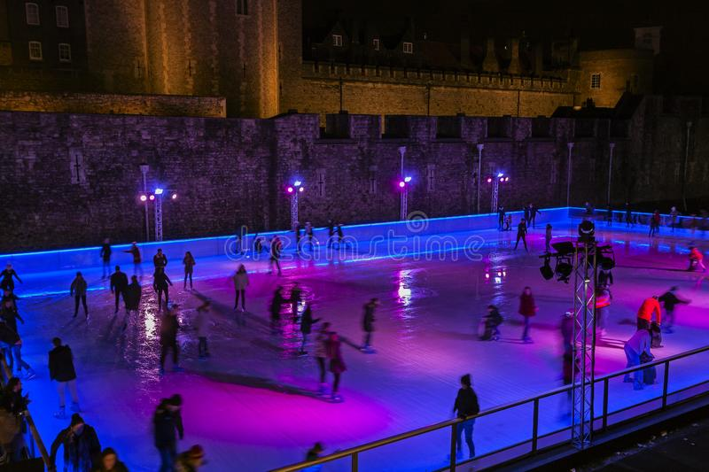 People Ice Skating on indoor Ice Rink royalty free stock image