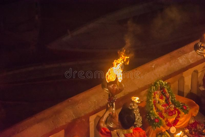 People from India performing ceremony in Varanasi, with fire on the banks of the Gages River. People from India performing ceremony in Varanasi, at night and stock photos