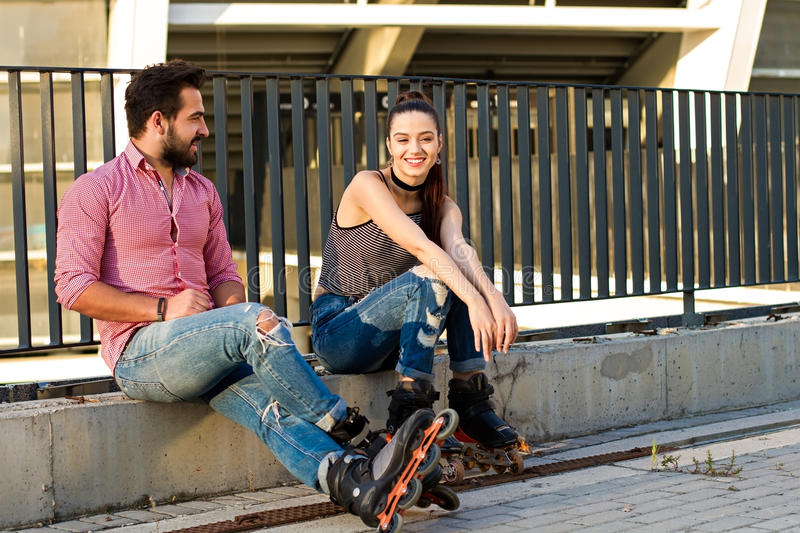 People on inline skates sitting. royalty free stock photo