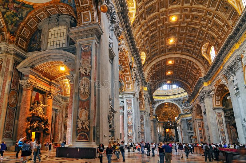 People at the interior of the Saint Peter Cathedral in Vatican.  stock photos