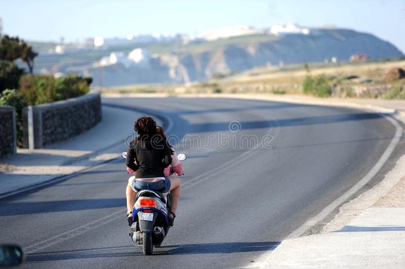 The people on the island of using motorcycle. Santorini is a famous island in the Aegean islands, is apart from the Athens 110 nautical miles, is base carat ze stock photo