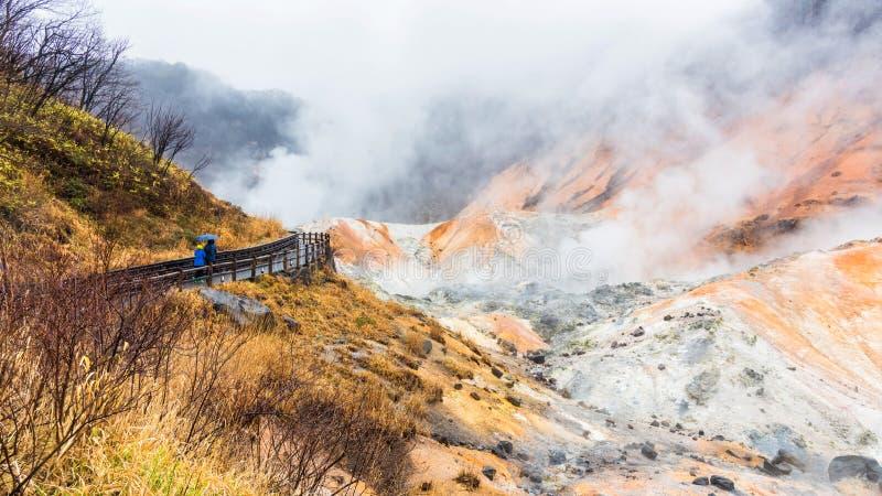 People at Jigokudani hell valley, Noboribetsu. People visit Jigokudani hell valley during heavy rain with dense sulfur gas in Noboribetsu, Hokkaido, Japan stock photo