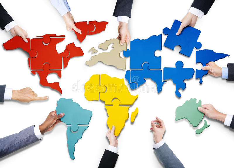 People with Jigsaw Puzzle Forming in World Map. Group of Business People with Jigsaw Puzzle Forming in World Map royalty free stock images