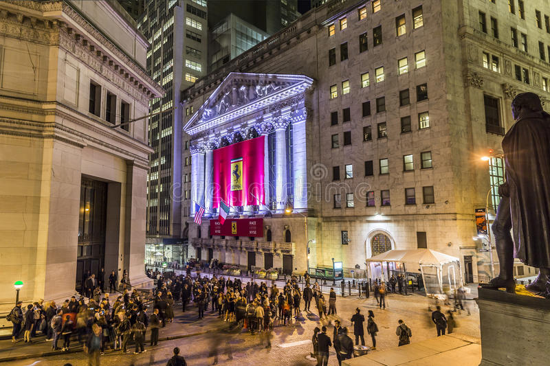 People join the party at wall street due to Ferrari Wall street stock image