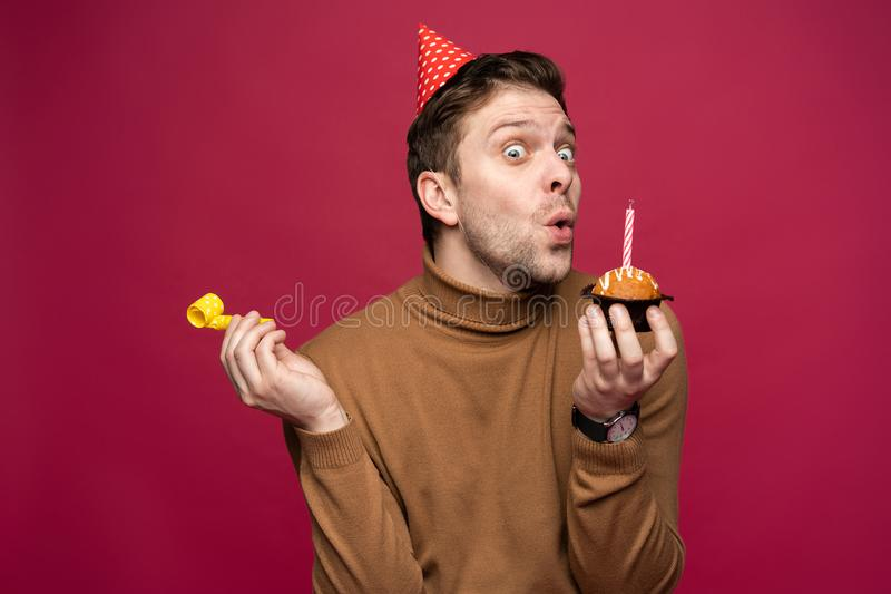 People, joy, fun and happiness concept. Relaxed happy birthday guy looking cheerful, smiling happily, posing for picture stock image