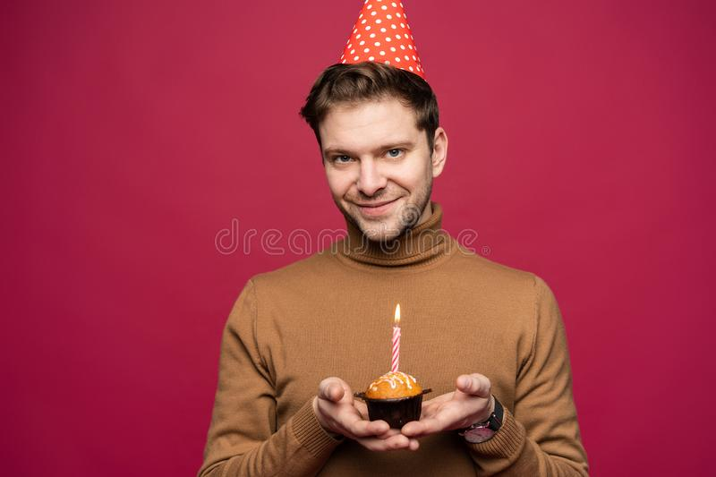 People, joy, fun and happiness concept. Relaxed happy birthday guy looking cheerful, smiling happily, posing for picture royalty free stock image