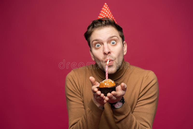 People, joy, fun and happiness concept. Relaxed happy birthday guy looking cheerful, smiling happily, posing for picture royalty free stock photography