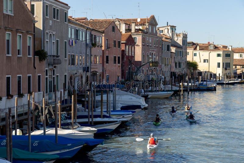 People kayaking in the Venetian canal. Venice, Italy. Group of people kayaking in the Venetian canals. Venice, Italy stock photos