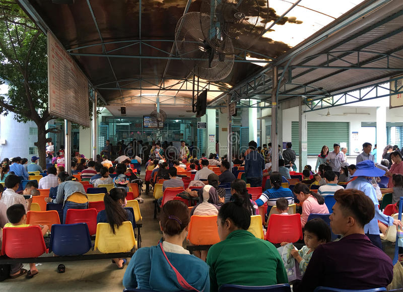 People at Kids Hospital in Vietnam. HO CHI MINH CITY, VIETNAM - JULY 2017: A lot of people sitting in the lobby of the Kids Hospital in Ly Thai To Street wait to royalty free stock images