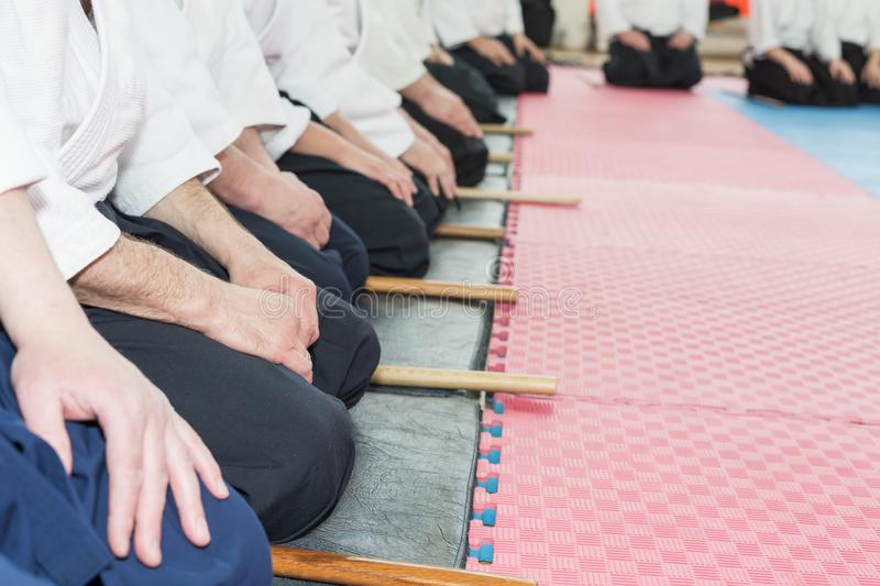 People in kimono on martial arts weapon training seminar. People in kimono sitting on tatami on martial arts weapon training stock photos