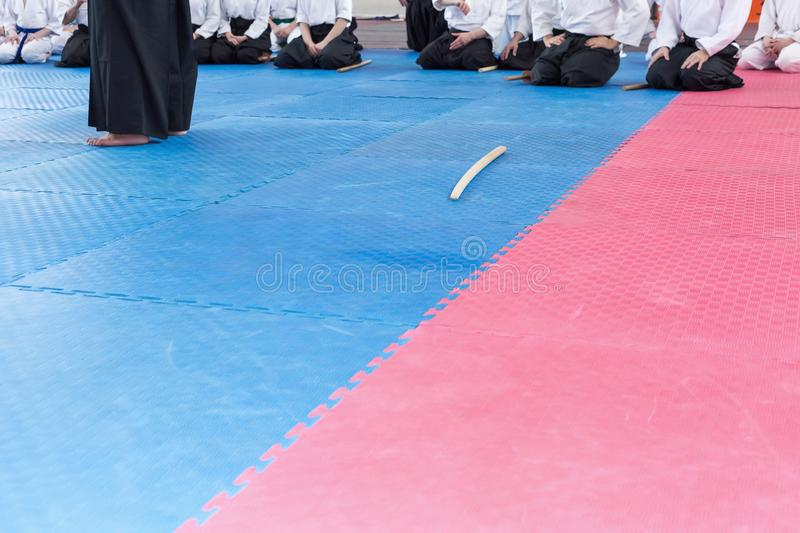 People in kimono on martial arts weapon training seminar. People in kimono sitting on tatami on martial arts weapon training royalty free stock images