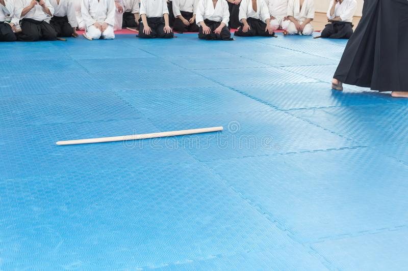 People in kimono on martial arts weapon training seminar. People in kimono sitting on tatami on martial arts weapon training royalty free stock photography