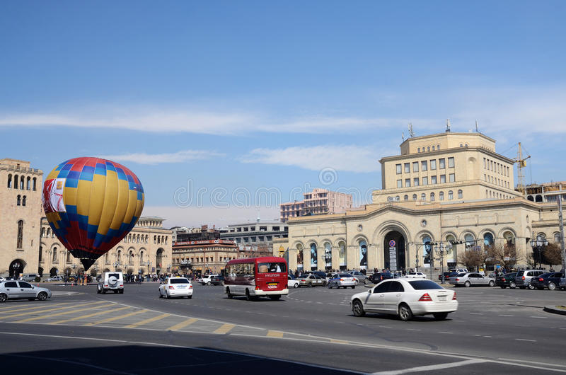 People launching balloon near the Government building on Republic square,Erevan royalty free stock image