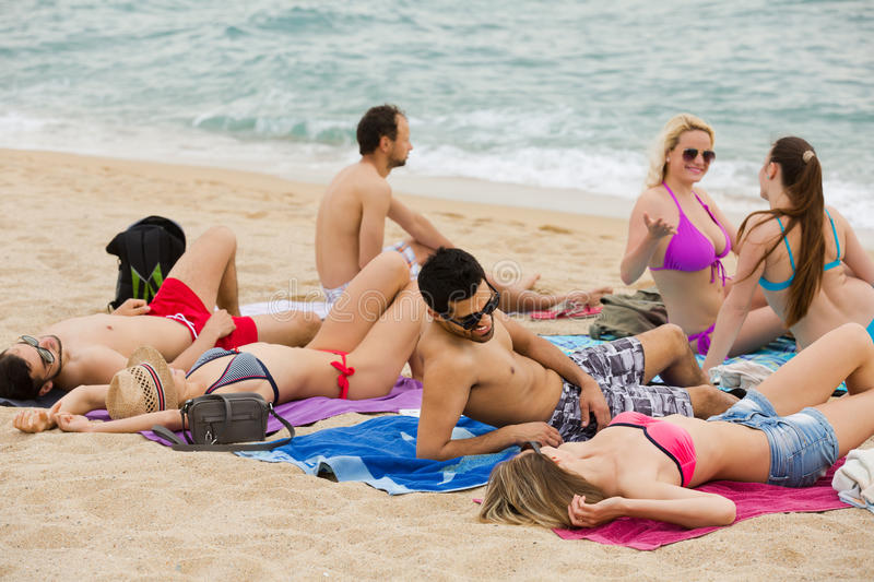 Download People Laying On Sand At Beach Stock Photo Image