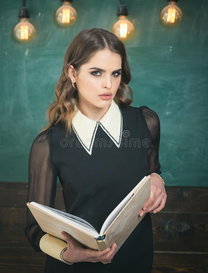 People learning education and school concept - students hands with books or textbooks writing. Student looks for stock photography