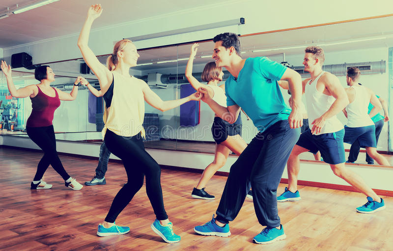 People learning swing at dance class stock photos