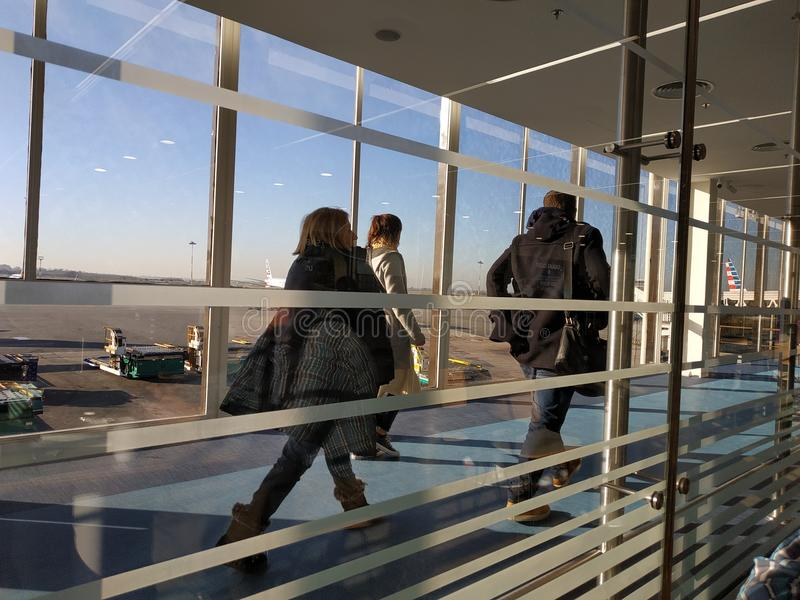 People leaving the airplane royalty free stock photo