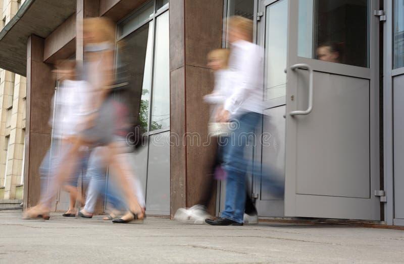 People leaving doors royalty free stock image