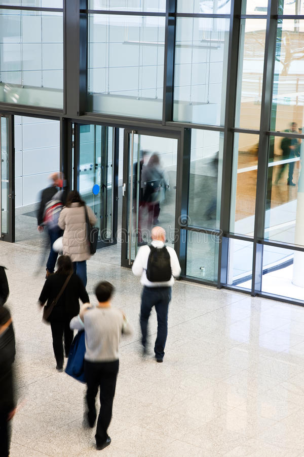 People Leaving an Office Building, Motion Blur stock photo