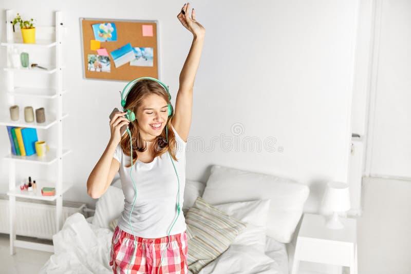 Happy woman in headphones having fun at home stock photos
