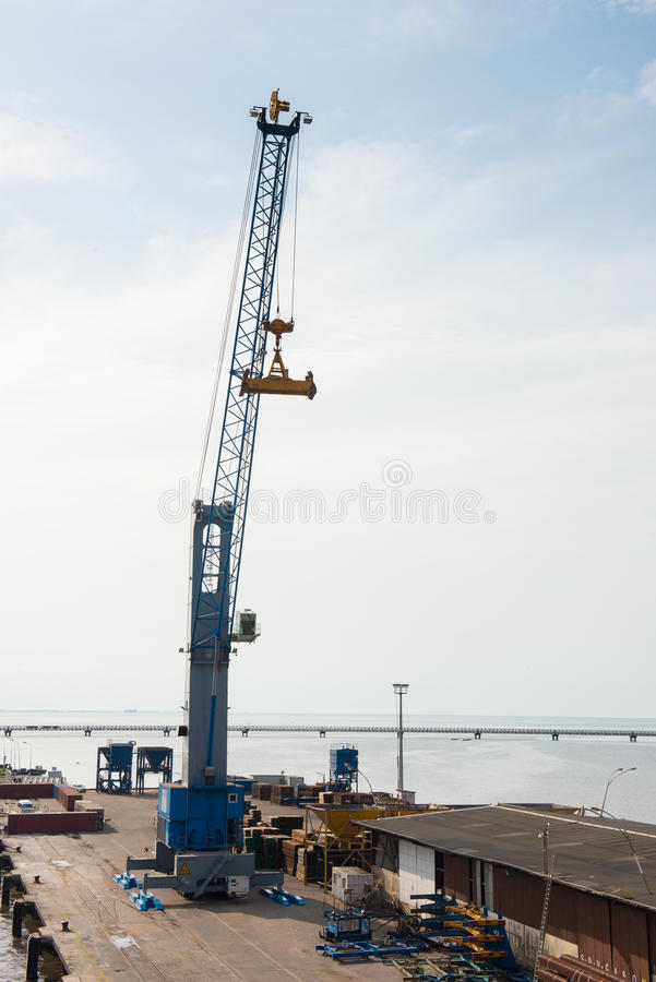 People in LIBREVILLE, GABON. LIBREVILLE, GABON - MAR 6, 2013: Crane in the Port of Libreville, Gabon. Port of Libreville is a trade center for a timber region royalty free stock image