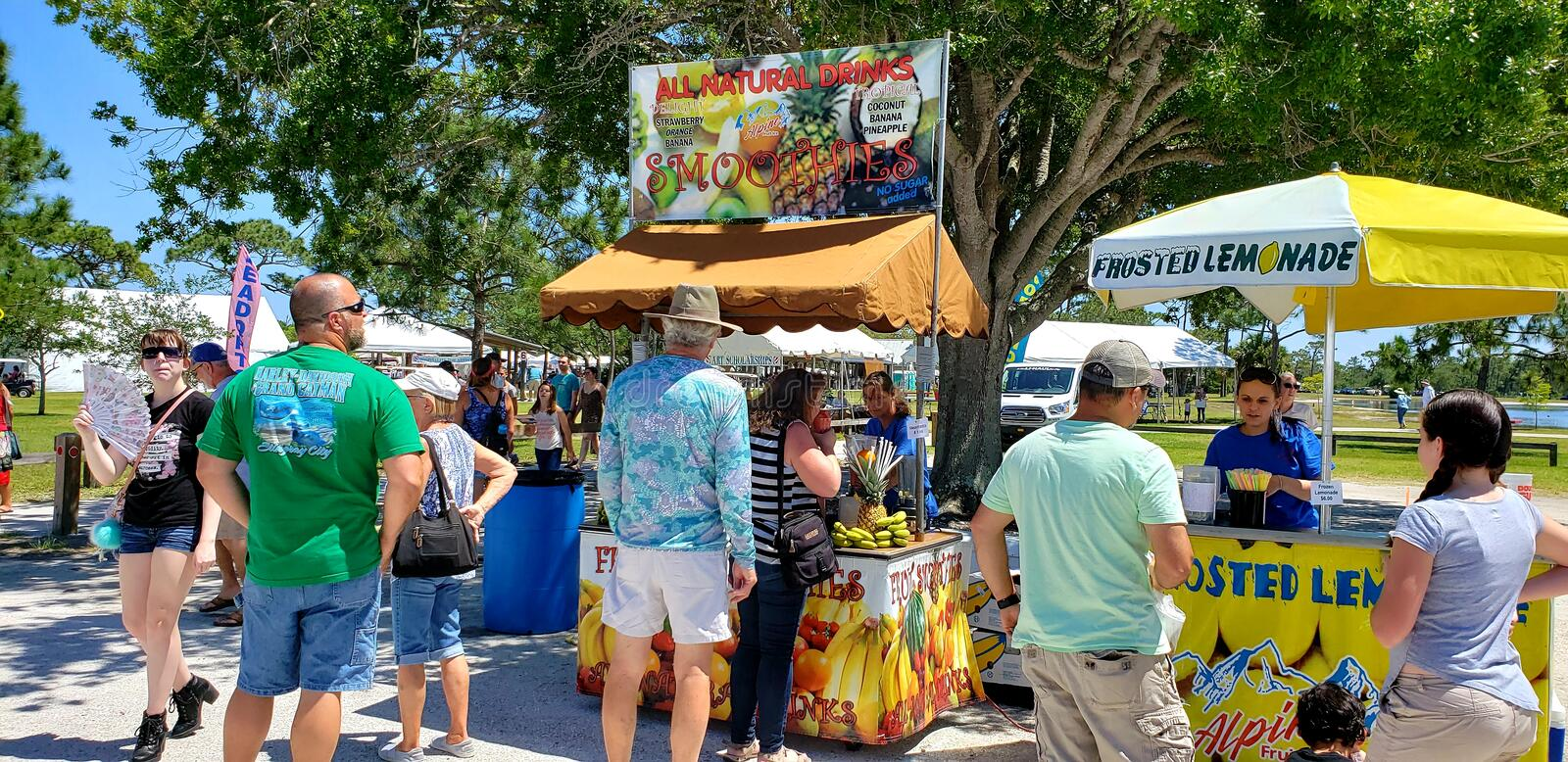 Food Vendors serving customers at The Melbourne FL Art Festival royalty free stock photography