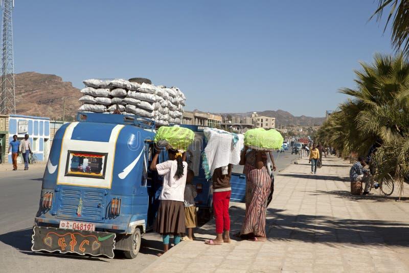 People loading a Auto rickshaw, Ethiopia. People load a auto rickshaw in Ethiopia, Africa stock image