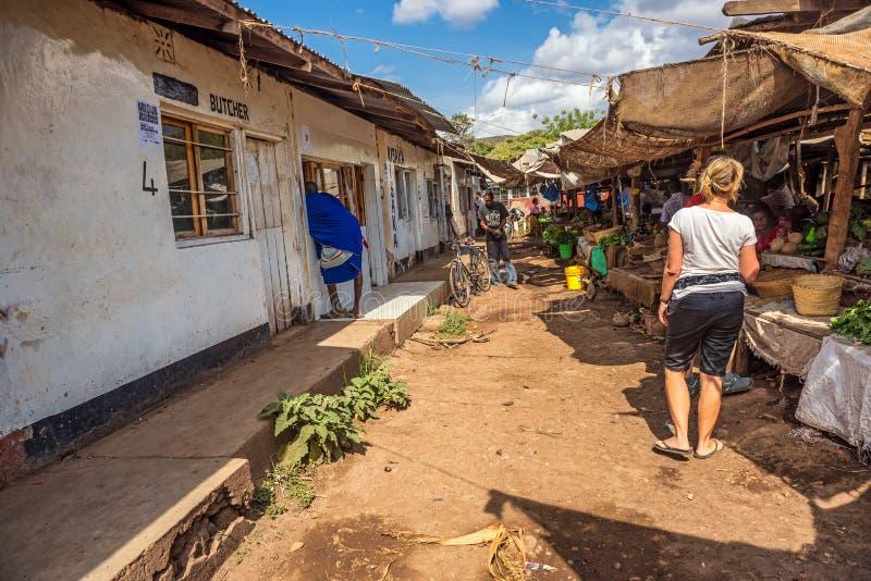 People at the local marketplace of Mto Wa Mbu, Tanzania. MTO WA MBU, ARUSHA, TANZANIA - OCTOBER 22, 2014 : People at the local marketplace of Mto Wa Mbu. Mto wa stock photo