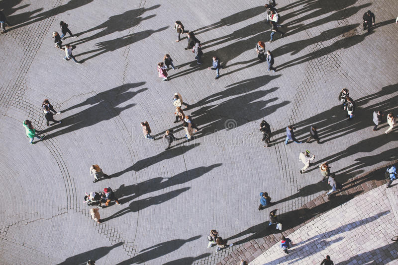 People with lolg shadows, top view. stock images