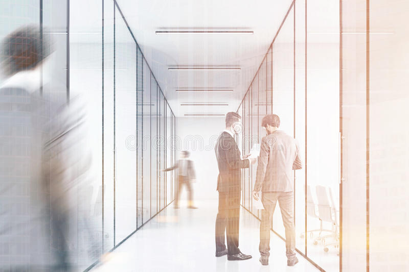 People in a long office corridor with glass walls. There are several conference rooms in it and. Concept of a successful company. 3d rendering. Toned image stock illustration